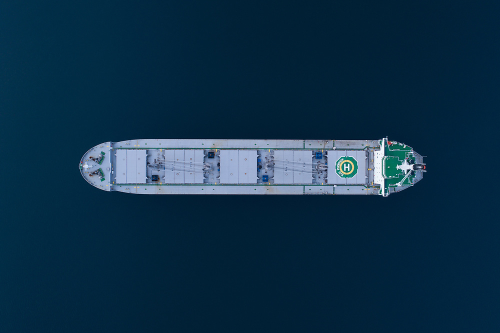Arial top down view of the bulk carrier 'IVS Phoenix' anchored in the port of Narvik in Northern Norway.