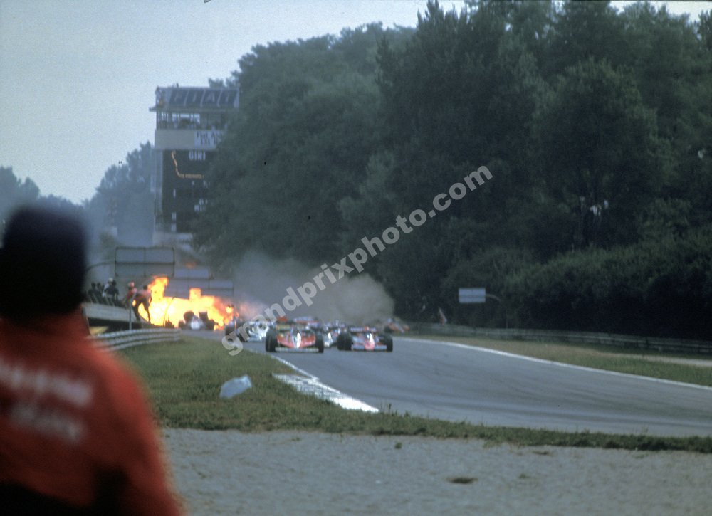 The Lotus-Ford of  Ronnie Peterson caught fire following a crash in the 1978 Italian Grand Prix at Monza. Photo: Grand Prix Photo