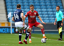 Joe Bryan of Bristol City takes on Jed Wallace of Millwall - Mandatory by-line: Robbie Stephenson/JMP - 07/04/2018 - FOOTBALL - The Den - London, England - Millwall v Bristol City - Sky Bet Championship