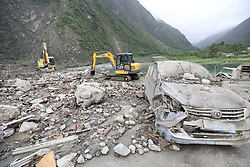 June 24, 2017 - Maoxian, China - Rescuers work at the accident site after a landslide occurred in Xinmo Village of Maoxian County, Tibetan and Qiang Autonomous Prefecture of Aba, southwest China's Sichuan Province. The rescue headquarters of the landslide in Sichuan Province has said the landslide buried 62 homes, and more than 120 people are thought to be missing. Currently, more than 1,000 workers with life-detection instruments are engaged in the search for survivors.  (Credit Image: © Jiang Hongjing/Xinhua via ZUMA Wire)