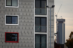 """© Licensed to London News Pictures . 11/10/2018. Salford , UK . GV of Hornbeam Court on The Square with temporary cladding fitted on lower floors and new Manchester Development known as """"The Twin Towers"""" in the background . Recently installed cladding at several council-owned tower blocks in Salford has been identified as having similar dangerous properties to that which was installed on the Grenfell Tower in London . Residents have been waiting months for clarification on what action will be taken to make their homes safe . Photo credit : Joel Goodman/LNP"""