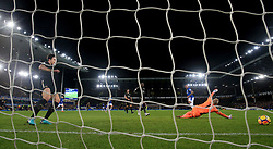 Everton's Theo Walcott (back right) scores his side's first goal of the game during the Premier League match at Goodison Park, Liverpool.
