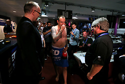 Mark Williams walks to his post match interview without any clothes on after winning the 2018 Betfred World Championship at The Crucible, Sheffield.