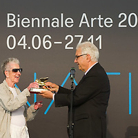 VENICE, ITALY - JUNE 04:  Paolo Baratta President of Biennale awards artist  Elaine Sturtevant  a Golden Lion for Lifetime Achievement at the Official Awards  of the 54th International Art Exhibition on June 4, 2011 in Venice, Italy. This year's Biennale is the 54th edition and will run from June 4th until 27 November.