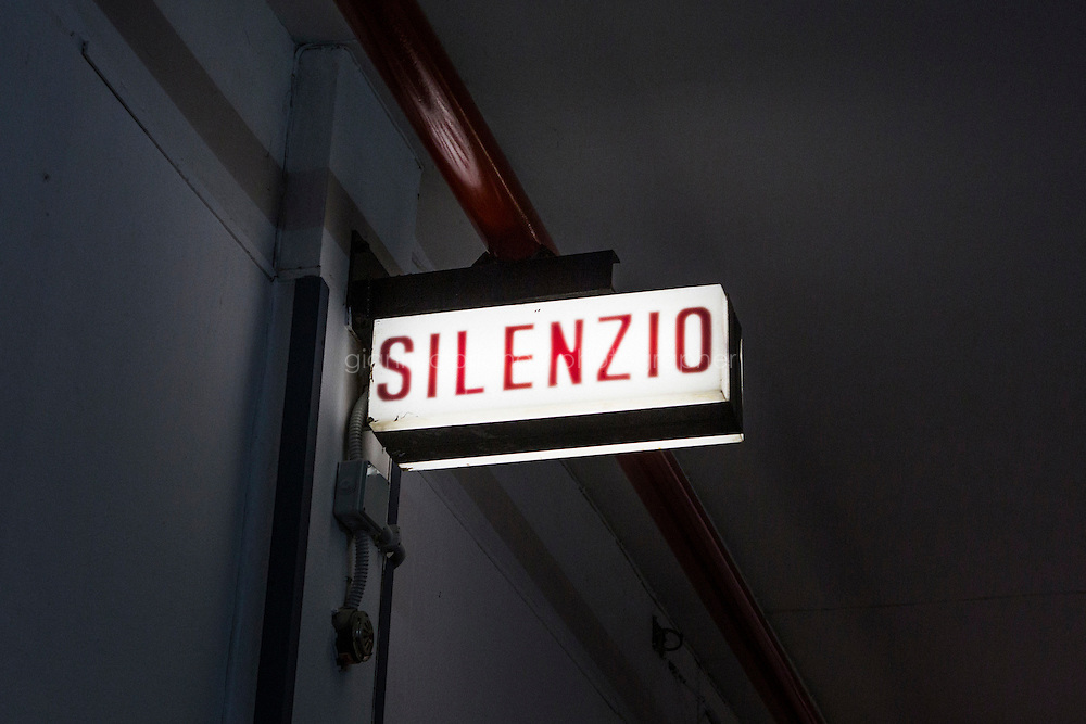 """ROME, ITALY - 30 MARCH 2015: A """"silence"""" sign above the entrance door of the Teatro 1 (Studio 1) of Cinecittà<br /> in Rome, Italy, on March 30th 2015.<br /> <br /> Italy instated a special 25% tax credit for film productions in 2010. The industry then lobbied to remove the credit's cap, and last July, Italy lifted its tax credit limit from €5 million per movie to €10 million per company per year. <br />  <br /> Cinecittà, a large film studio in Rome, is considered the hub of Italian cinema. The studios were founded in 1937 by Benito Mussolini as part of a scheme to revive the Italian film industry. In the 1950s, the number of international productions being made here led to Rome being dubbed as the """"Hollywood on the Tiber"""". In the 1950s, Cinecittà was the filming location for several large American film productions like Ben-Hur, and then became the studio most closely associated with Federico Fellini.<br /> After a period of near-bankruptcy, the Italian Government privatized Cinecittà in 1997, selling an 80% stake.<br /> <br /> Currently Ben-Hur and Zoolander 2 are booked into Cinecittà Studios."""
