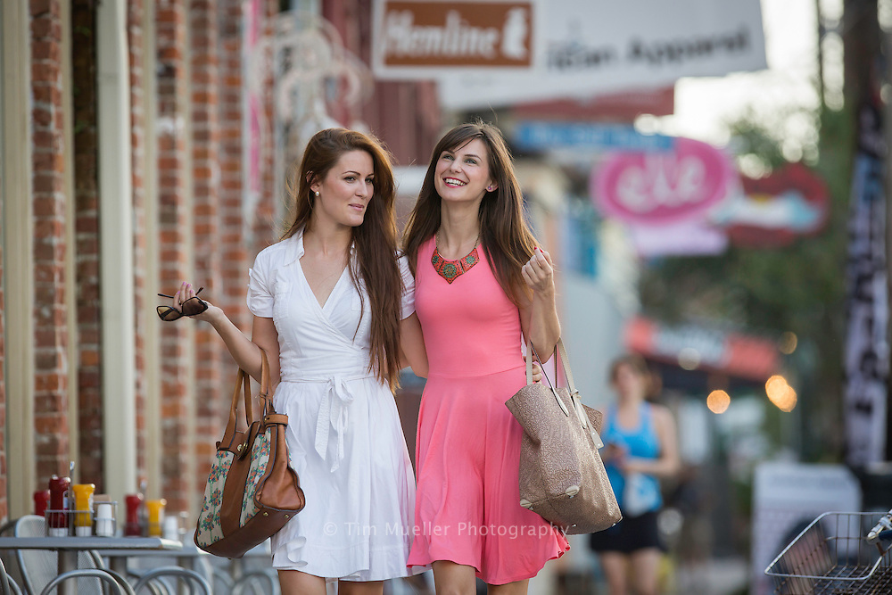 Friends, from left, Neda Dragicevic and Miladinka Stopari shop along Magazine Street in New Orleans, La.