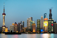 Shanghai, China - April 10, 2013: pudong waterfront at sunset at the city of Shanghai in China on april 10th, 2013