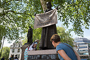 Admirers of suffragist Millicent Garrett Fawcetts statue, the first woman to appear among an all-male Parliament Square, on 9th May 2018, in London, England. Dame Millicent Garrett Fawcett GBE was a British feminist, intellectual, political leader, activist and writer. She is primarily known for her work as a campaigner for womens suffrage.
