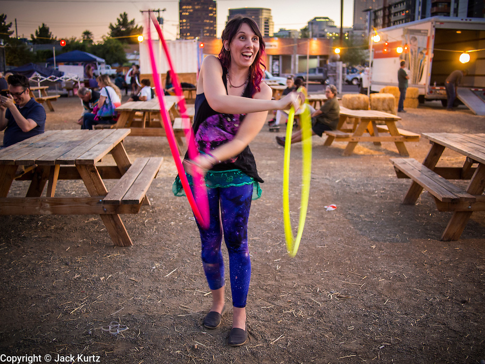 09 NOVEMBER 2013 - PHOENIX, AZ:  A woman who performs with hulahoops at the 7th annual Phoenix Annual Parade of the Arts. The arts walk/parade started in 2006 and now draws hundreds of people in downtown Phoenix.    PHOTO BY JACK KURTZ