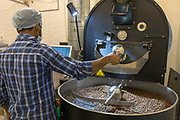 A coffee roaster at Blue Tokai Coffee Shop, Champa Gali, New Delhi, India. Champa Gali is the latest and most intimate of Delhis urban creative villages.