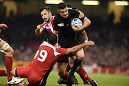 Daniel Carter of New Zealand is stopped by Georgia's Giorgi Begadze.  Rugby World Cup 2015 pool c match, New Zealand v Georgia at the Millennium Stadium in Cardiff, South Wales  on Friday 2nd October 2015.<br /> pic by  Andrew Orchard, Andrew Orchard sports photography.