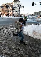 Brookline, MA 02/10/2013<br /> A pedestrian runs through a deep pool of icy slush in Coolidge Corner on Sunday afternoon.