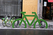 Giant green bicycle from the cycle parking brand Cyclehoop on 1st July 2020 in London, United Kingdom. Cyclehoop work with local councils to provide managed cycle parking solutions.