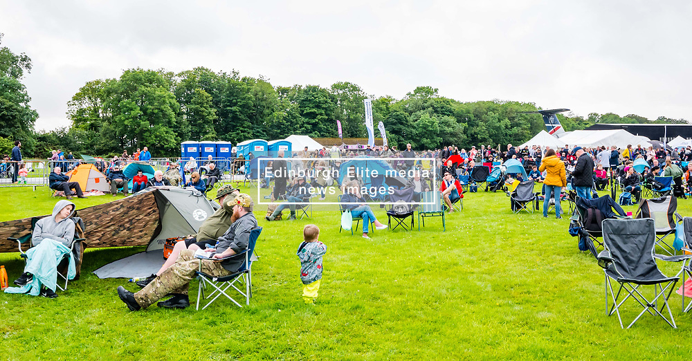 Pictured: Scotland's National Airshow, East Fortune, East Lothian, Scotland, United Kingdom, 27 July 2019 . A packed programme of aircraft old and new planned to take to the skies for the aerial display was marred by poor weather at airfields around the country which meant that many of the promised flights were unable to perform. The display is delayed and the crowd waits.<br /> Sally Anderson | EdinburghElitemedia.co.uk