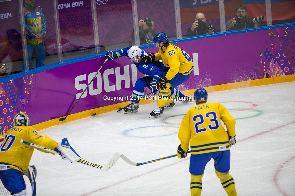 Erik Karlsson (SWE)-65, Ales Music (SLO)-16 during Sweden vs Slovenia game at the Olympic Winter Games, Sochi 2014