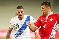 ATHENS, GREECE - OCTOBER 11: Dimitris Kourbelisof Greece and Igor Armaşof Moldova during the UEFA Nations League group stage match between Greece and Moldova at OACA Spyros Louis on October 11, 2020 in Athens, Greece. (Photo by MB Media)