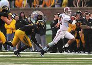 Alabama Crimson Tide quarterback AJ McCarron (10) evades a Missouri player in the first half. The Alabama Crimson Tide defeated the Missouri Tigers 42-10 at Memorial Stadium in Columbia, Missouri on October 13, 2012.