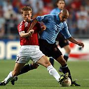 Uruguay's Gustavo Varela and Denmark's Martin Jorgensen