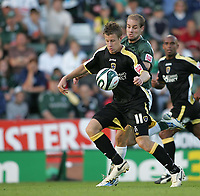 Photo: Lee Earle.<br /> Plymouth Argyle v Cardiff City. Coca Cola Championship. 15/09/2007. Cardiff's Paul Parry (L) holds off Marcel Seip.