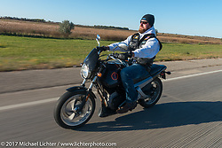 Austin Wellman of the Old Cronies, Aberdeen SD riding his Buell Blast in the USS South Dakota submarine flag relay across South Dakota. Groton, SD. USA. Sunday October 8, 2017. Photography ©2017 Michael Lichter.