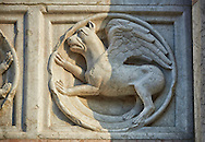 Medieval relief sculptures of mythical Griffin on the exterior of the Romanesque Baptistery of Parma, circa 1196, (Battistero di Parma), Italy .<br /> <br /> If you prefer you can also buy from our ALAMY PHOTO LIBRARY  Collection visit : https://www.alamy.com/portfolio/paul-williams-funkystock/romanesque-art-antiquities.html<br /> Type -     Parma    - into the LOWER SEARCH WITHIN GALLERY box. <br /> <br /> Visit our ROMANESQUE ART PHOTO COLLECTION for more   photos  to download or buy as prints https://funkystock.photoshelter.com/gallery-collection/Medieval-Romanesque-Art-Antiquities-Historic-Sites-Pictures-Images-of/C0000uYGQT94tY_Y