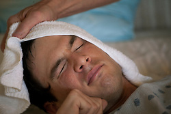 Chris Cox, 29, a traumatic brain injury survivor, is seen in Destin, Fla., Nov. 20, 2011. Cox was left with debilitating back pain after an A.T.V. accident. He underwent physical therapy to no avail and accidentally overdosed on Oxycontin, leaving him clinically deceased for 15 to 30 minutes. He was revived but suffered severe lack of oxygen to his brain and was diagnosed as minimally conscious. Cox's family entered him into a clinical trial, testing medicines that evoked Òparadoxical excitation,Ó such as Ambien, and have witnessed a heightened sense of awareness in their son.