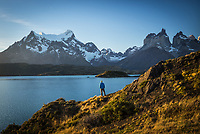 A lone hiker takes in the epic views of Torres del Paine National Park, Patagonia, Chile