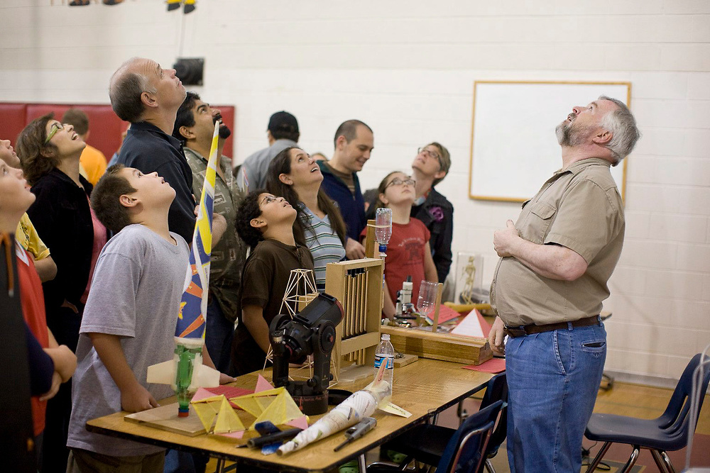 """Austin, TX December 1, 2007: Middle school science  teacher Tom Campbell (r)  meets parents and potential students at a Saturday morning """"magnet fair"""" intended to attract bright, qualified students to specialized Kealing Middle School programs. ©Bob Daemmrich"""