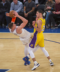 December 12, 2017 - Manhattan, NY, USA - The Los Angeles Lakers' Lonzo Ball (2) trips up the New York Knicks' Kristaps Porzingis at Madison Square Garden in New York on Tuesday, Dec. 12, 2017. The Knicks won, 113-109, in overtime. (Credit Image: © Howard Simmons/TNS via ZUMA Wire)