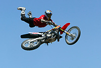 """Jul 01, 2003; Anaheim, California, USA; Moto X star athlete MIKE METZGER executing a tremendous stunt feet free with a full sized motobike at the opening of Disney's California Adventure """"X Games Experience"""".  Disney park has built two X-Arena's specifically for this 41 day event highlighting extreme sports for the launch of the 2003 ESPN X Games.<br />Mandatory Credit: Photo by Shelly Castellano/Icon SMI<br />(©) Copyright 2003 by Shelly Castellano"""