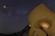 Skull Rock lit up at night in Joshua Tree National Park, California, USA