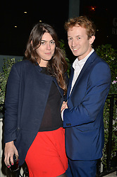 AMBER GUINNESS and MATTHEW BELL at a private view of William Roper-Curzon's latest paintings held at Julian Hartnoll, 37 Duke Street, St.James's, London on 9th October 2014.