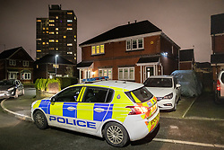 © Licensed to London News Pictures. 25/01/2020. Manchester, UK. A police car guards the front of a house on Capricorn Road in Blackley , North Manchester . It's reported locally that a man was arrested early this morning , forensic examiners were seen entering and leaving the house and that several coffins were removed from the house during the course of the day . A Pearson's Funeral van is also reported to have been removed by police during the course of the day . Photo credit: Joel Goodman/LNP