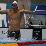 Camille Lacourt, France, in action in the Men's 100m backstroke heats during the swimming heats at the Aquatic Centre at Olympic Park, Stratford during the London 2012 Olympic games. London, UK. 29th July 2012. Photo Tim Clayton