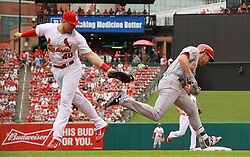June 26, 2017 - St Louis, MO, USA - Cincinnati Reds' Adam Duvall, right, reaches first base past the tag attempt by St. Louis Cardinals first baseman Luke Voit in the second inning during a game between the St. Louis Cardinals and the Cincinnati Reds on Monday, June 26, 2017, at Busch Stadium in St. Louis. Cardinals third baseman Jedd Gyorko was charged with a throwing error on the play. The Cardinals won, 8-2. (Credit Image: © Chris Lee/TNS via ZUMA Wire)
