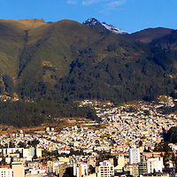 Americas, South America, Ecuador, Quito. At over 9,000 feet in elevation, the capitol of Ecuador, Quito, sits in a valley surrounded by the Andes mountains, providing countless scenic vistas. Quito was the first established  UNESCO World Heritage site..