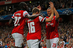 27.08.2013, Emirates Stadion, London, ENG, UEFA CL Qualifikation, FC Arsenal vs Fenerbahce Istanbul, Rueckspiel, im Bild Arsenal's Yaya Sanogo Arsenal's Aaron Ramsey and Arsenal's Kieran Gibbs celebrates the 2nd goal during the UEFA Champions League Qualifier second leg match between FC Arsenal and Fenerbahce Istanbul at the Emirates Stadium, United Kingdom on 2013/08/27. EXPA Pictures © 2013, PhotoCredit: EXPA/ Mitchell Gunn<br /> <br /> ***** ATTENTION - OUT OF GBR *****
