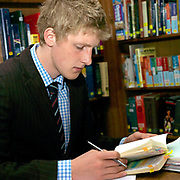A pupil working in the library at Ampleforth College, North Yorkshire, UK. Ampleforth College is a coeducational independent day and boarding school in the village of Ampleforth, North Yorkshire, England. It opened in 1802 as a boys' school, and is run by the Benedictine monks and lay staff of Ampleforth Abbey.