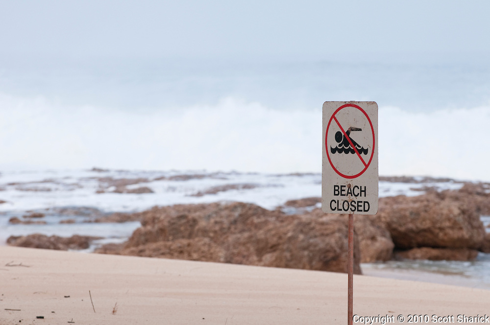 A sign warns people that the beach is closed.