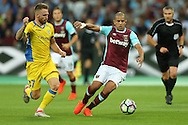Sofiane Feghouli of West Ham United goes past Zan Majer of NK Domzale. UEFA Europa league, 3rd qualifying round match, 2nd leg, West Ham Utd v NK Domzale at the London Stadium, Queen Elizabeth Olympic Park in London on Thursday 4th August 2016.<br /> pic by John Patrick Fletcher, Andrew Orchard sports photography.
