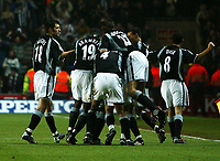 Photo. Andrew Unwin.<br /> Southampton v Newcastle United, FA Cup Third Round, Friends Provident St Marys Stadium, Southampton 03/01/2004.<br /> Newcastle celebrate after scoring their second goal.