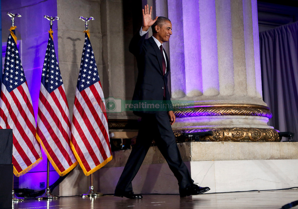 US President Barack Obama leaves after speaking at the 2016 White House Tribal Nations Conference at the Andrew W. Mellon Auditorium, September 26, 2016, Washington, DC. The conference provides tribal leaders with opportunity to interact directly with federal government officials and members of the White House Council on Native American Affairs. (Pool/Aude Guerrucci)