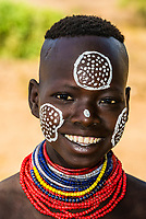 Kara tribe girl with chalk face painting, Omo Valley, Ethiopia.