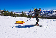 Backcountry skier towing a sled, Yosemite National Park, California