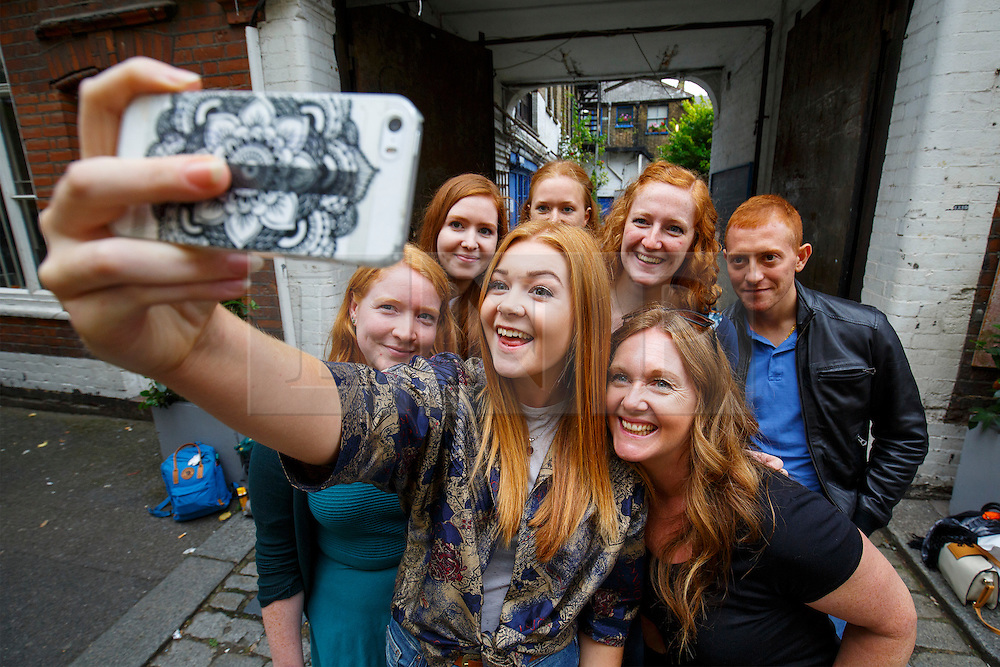 © Licensed to London News Pictures. 17/09/2016. London, UK. A group of ginger people pose for a selfie as hundreds of redheads attend Redhead Day UK event in Angel, London on Saturday, 17 September 2016. Natural redhead visitors get chance to celebrate their ginger genes and shop specialised products, see ginger related exhibitions and live performances. Photo credit: Tolga Akmen/LNP