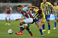 Jonathan Calleri of West Ham United blocks the ball from Matty Pearson of Accrington Stanley. EFL Cup, 3rd round match, West Ham Utd v Accrington Stanley at the London Stadium, Queen Elizabeth Olympic Park in London on Wednesday 21st September 2016.<br /> pic by John Patrick Fletcher, Andrew Orchard sports photography.