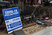 A notice containing COVID-19 precautions is displayed in the window of a tailors' shop on 26 September 2020 in Eton, United Kingdom. The Royal Borough of Windsor and Maidenhead is aware of a rise in local coronavirus infections, has a COVID-19 outbreak management plan in place to try to ensure that the numbers do not increase further and has requested access to more coronavirus testing sites with this in mind.