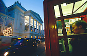 LONDON, ENGLAND..Covent Garden, Royal Opera House. Public phone both with callgirl ads..(Photo by Heimo Aga)