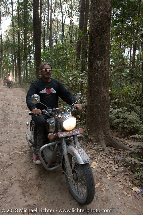 Beanre (Kevin Doebler) riding out through the forest from the Kusma Gyadi Bridge on Day-7 of our Himalayan Heroes adventure riding from Tatopani to Pokhara, Nepal. Monday, November 12, 2018. Photography ©2018 Michael Lichter.