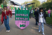 Climate activists, including many families, take part in a Rewild Royal Land procession to Buckingham Palace organised by Wild Card, a new campaign calling on the UK's biggest landowners to rewild, and 38 Degrees on 9th October 2021 in London, United Kingdom. Campaigners including conservationist and broadcaster Chris Packham are calling on the Royal Family, the largest landowning family in the UK, to rewild their estates in order to assist with tackling the climate crisis and a 14-year-old boy presented a petition at the gates of Buckingham Palace signed by over 100,000 people.